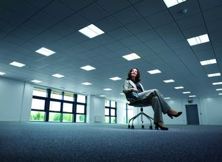 woman alone in empty office